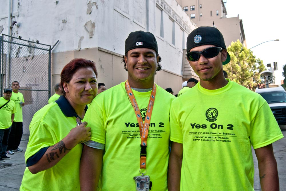 Image of three Alt 2 supporters wearing shirts that read 'Yes on 2.'